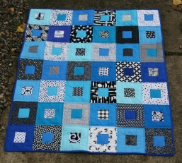 black and blue square in square quilt