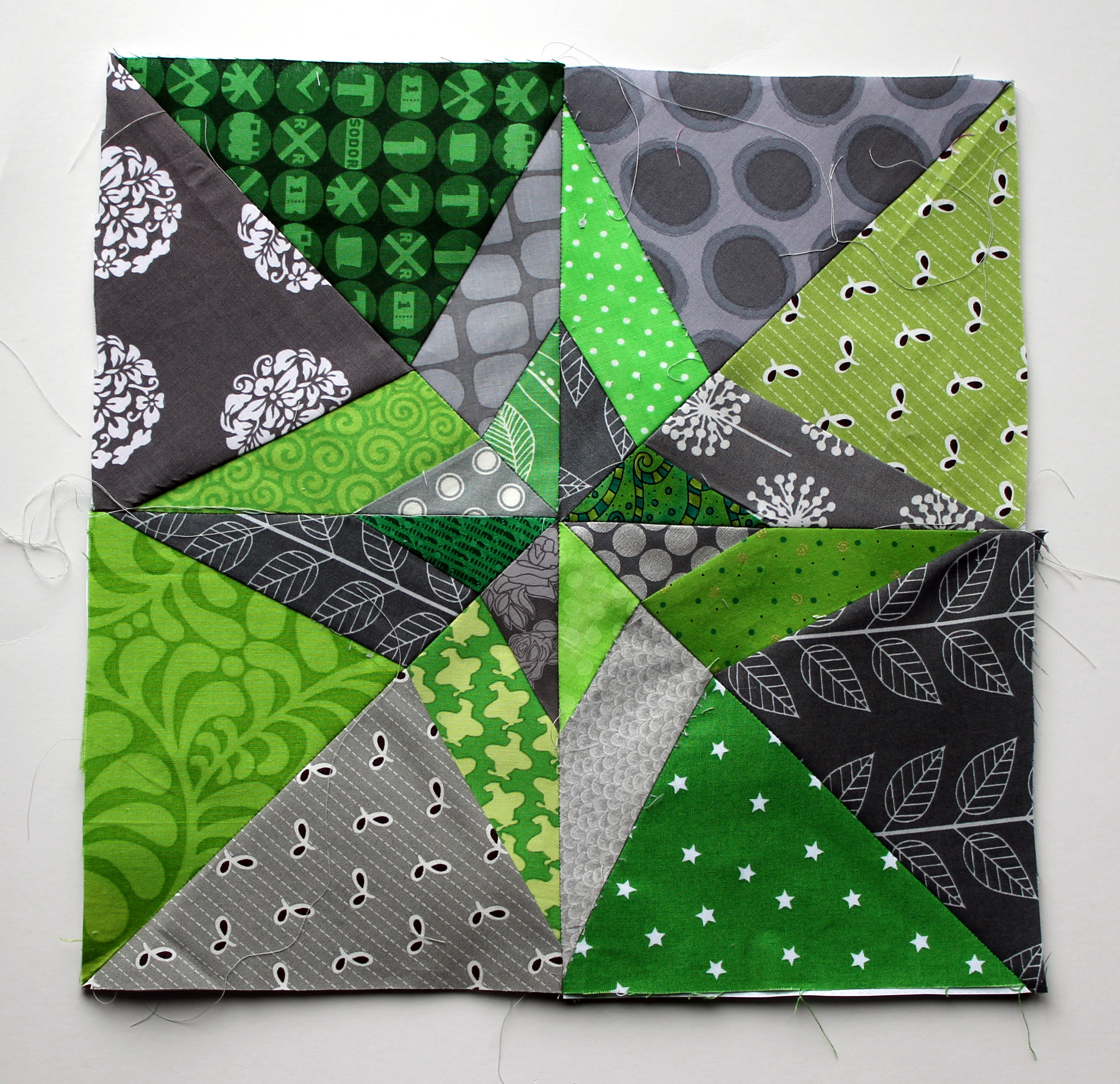 paper piecing night & day quilt block in modern grey & green