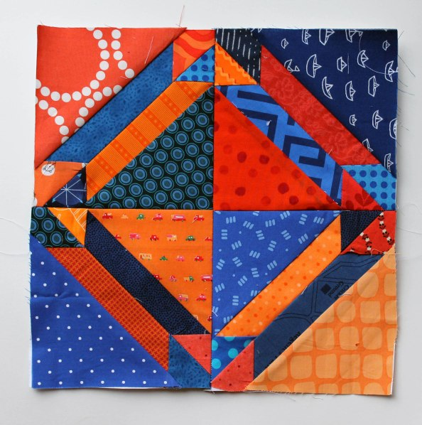 modern scrap quilt take on gretchen block pattern