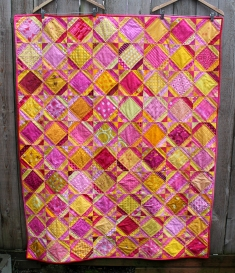 Bright easy kids quilt made with pink and yellow fabric