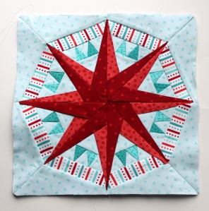 Paper piecing star pattern red aqua