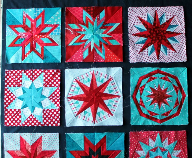 navy sashing on paper pieced star sampler quilt