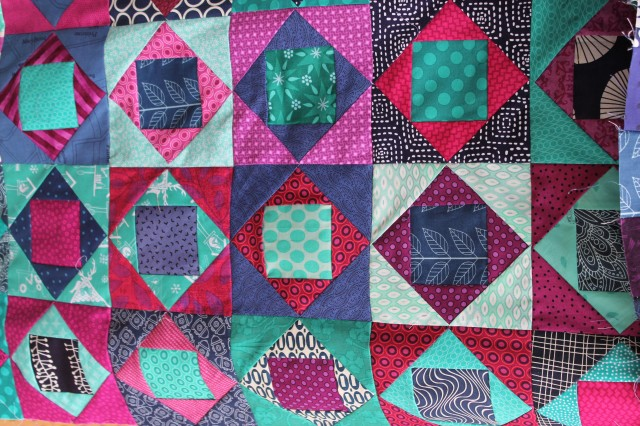 paper pieced square in square modern  scrap quilt