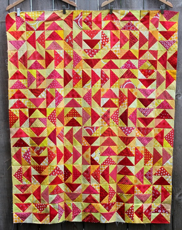 modern scrap flying geese quilt