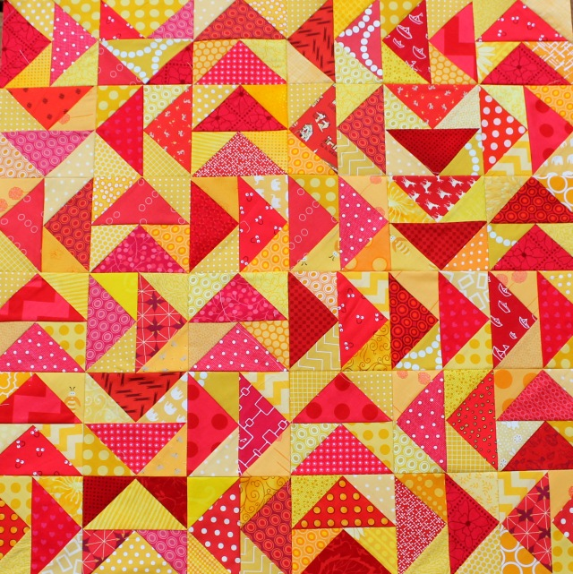 modern scrap flying geese quilt top