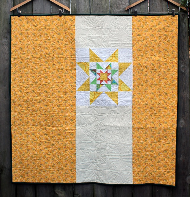 back of green yellow star quilt