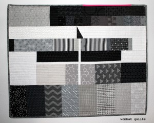 finished grey card quilt