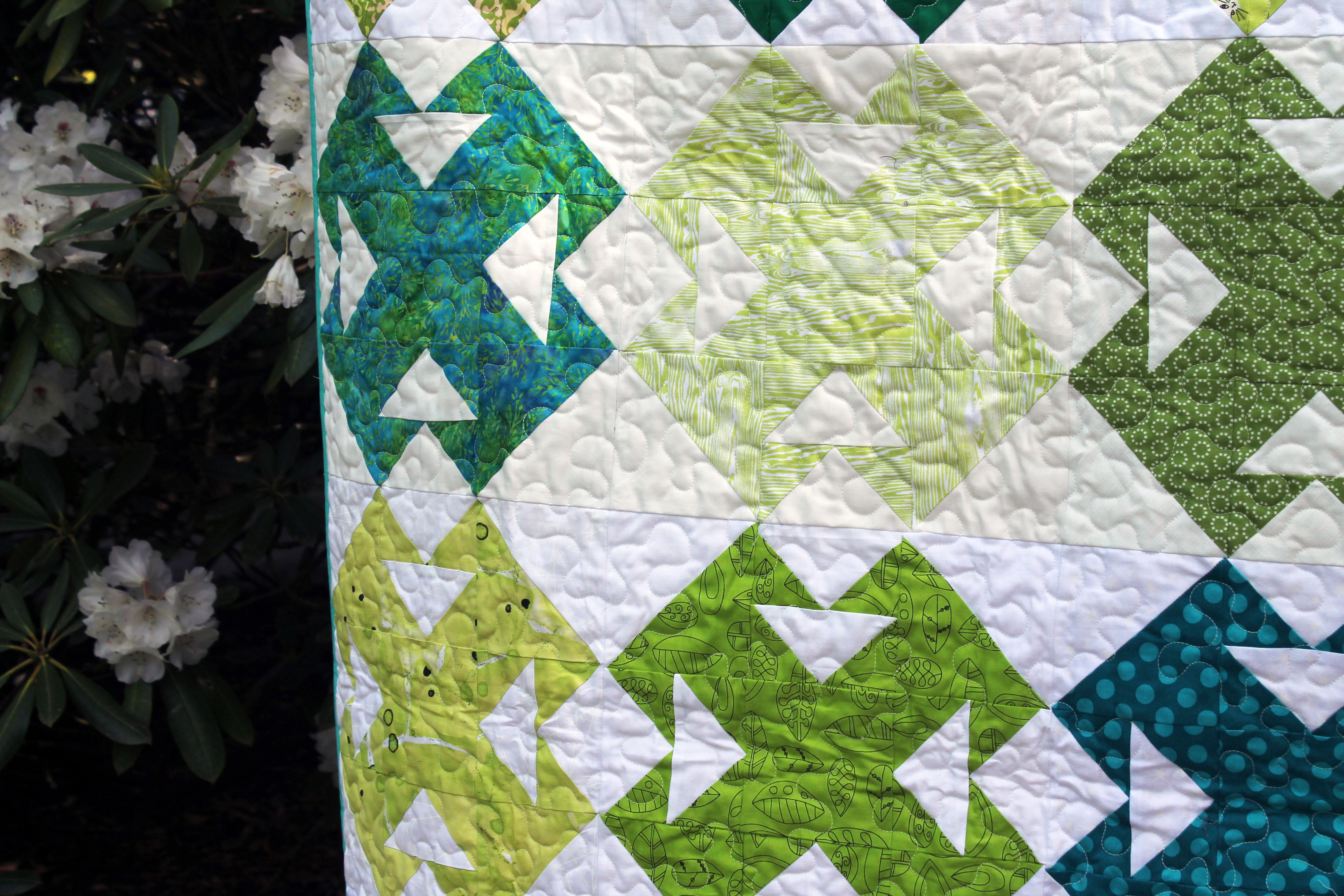green quilt detail