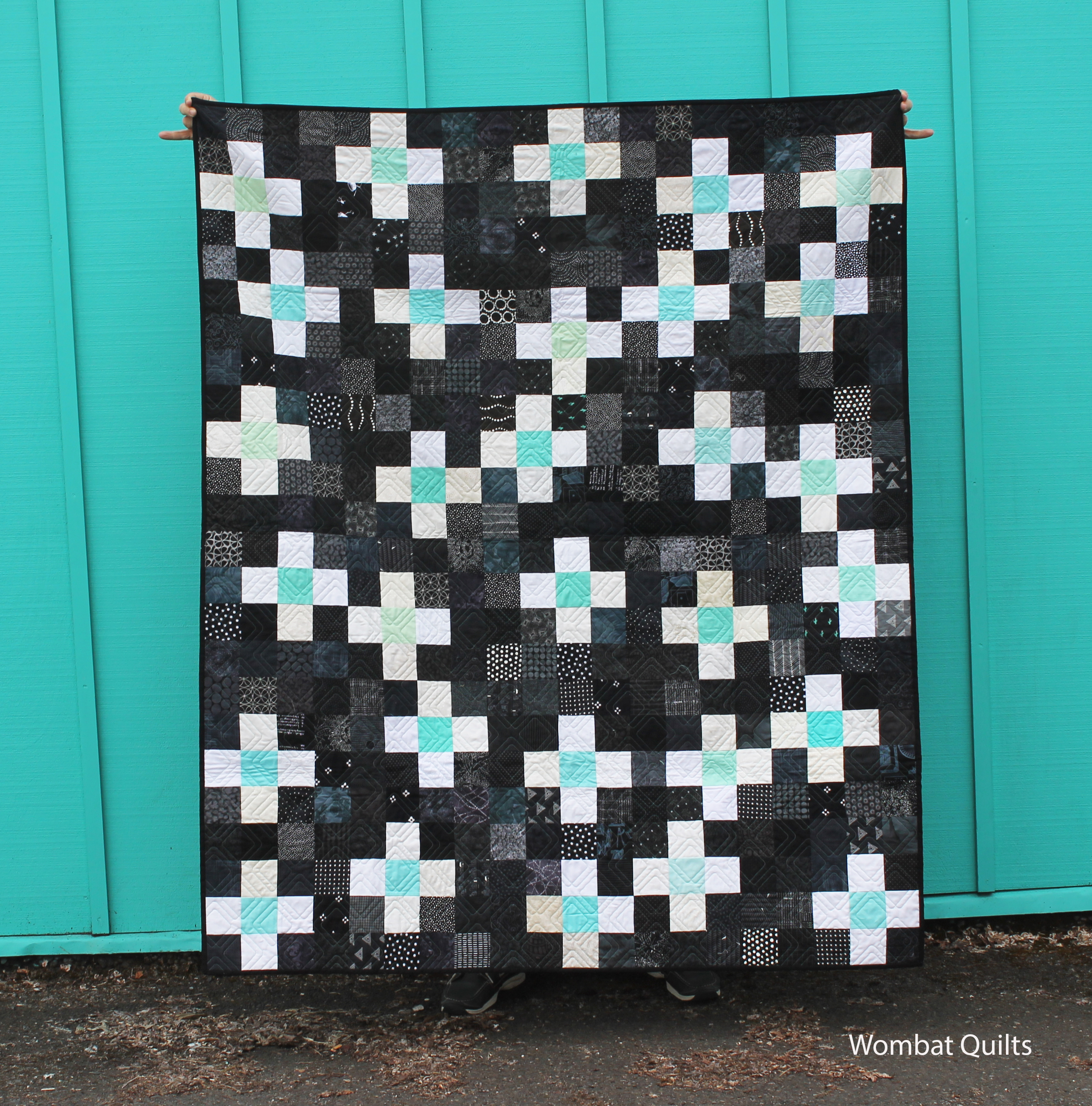 finished aqua cross quilt